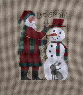 2018 Schooler Santa - Cross Stitch Pattern by Prairie Schooler Model stitched on 18 Ct. Putty Khaki Davos using DMC floss. Stitch count 75x57.